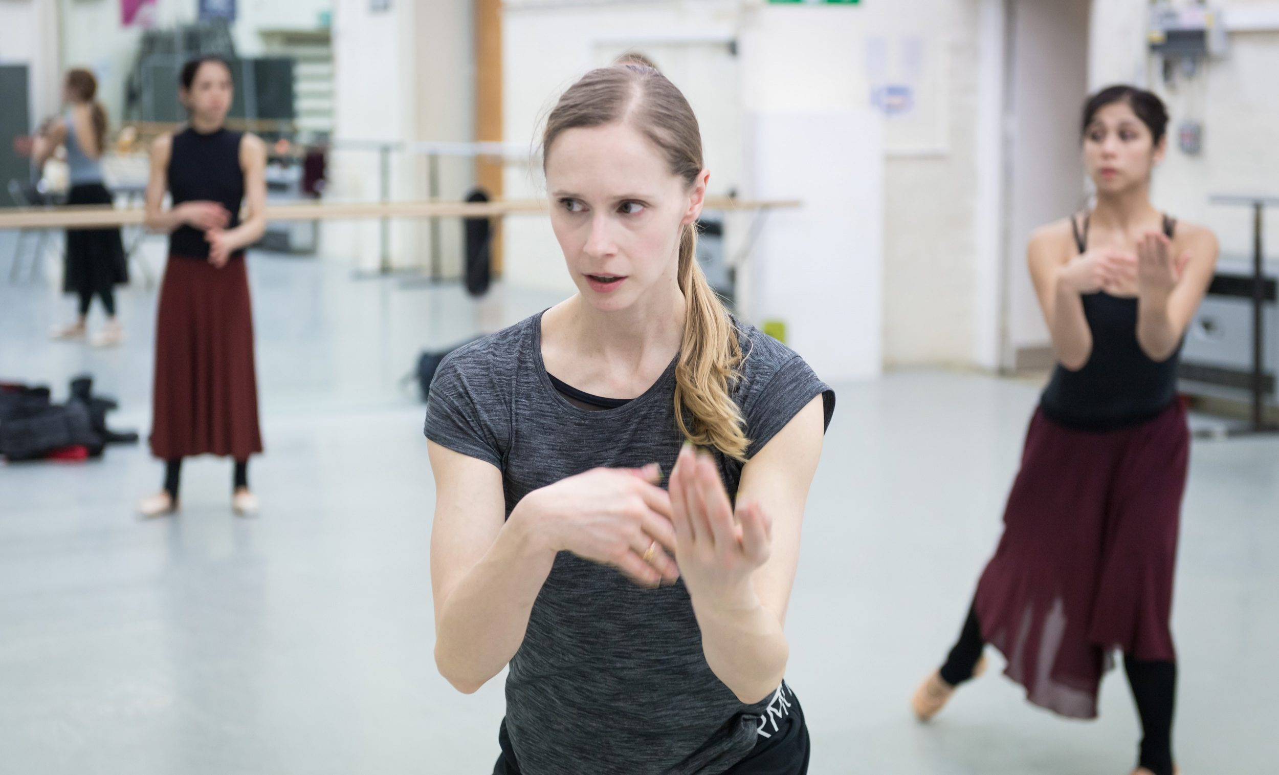 Stina Quagebeur leading a Nora rehearsal with Crystal Costa (right) and Erina Takahashi (left) © Ian Gavan