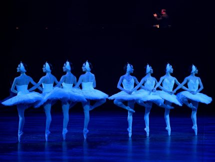 Eight Artists of English National Ballet perform the cygnet variation in Swan Lake in-the-round